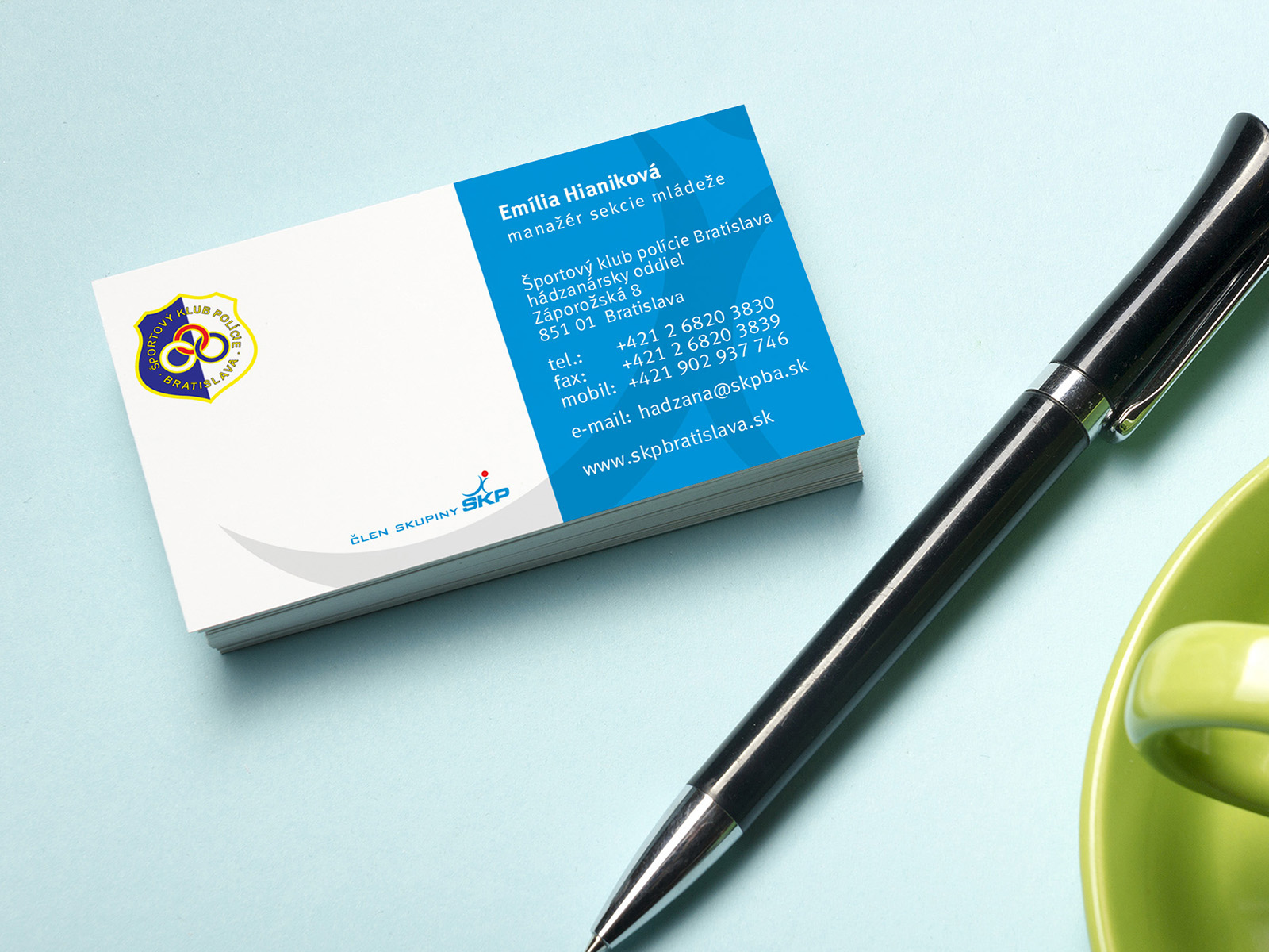 Business card blank over coffee cup and pen at office table. Corporate stationery branding mock-up